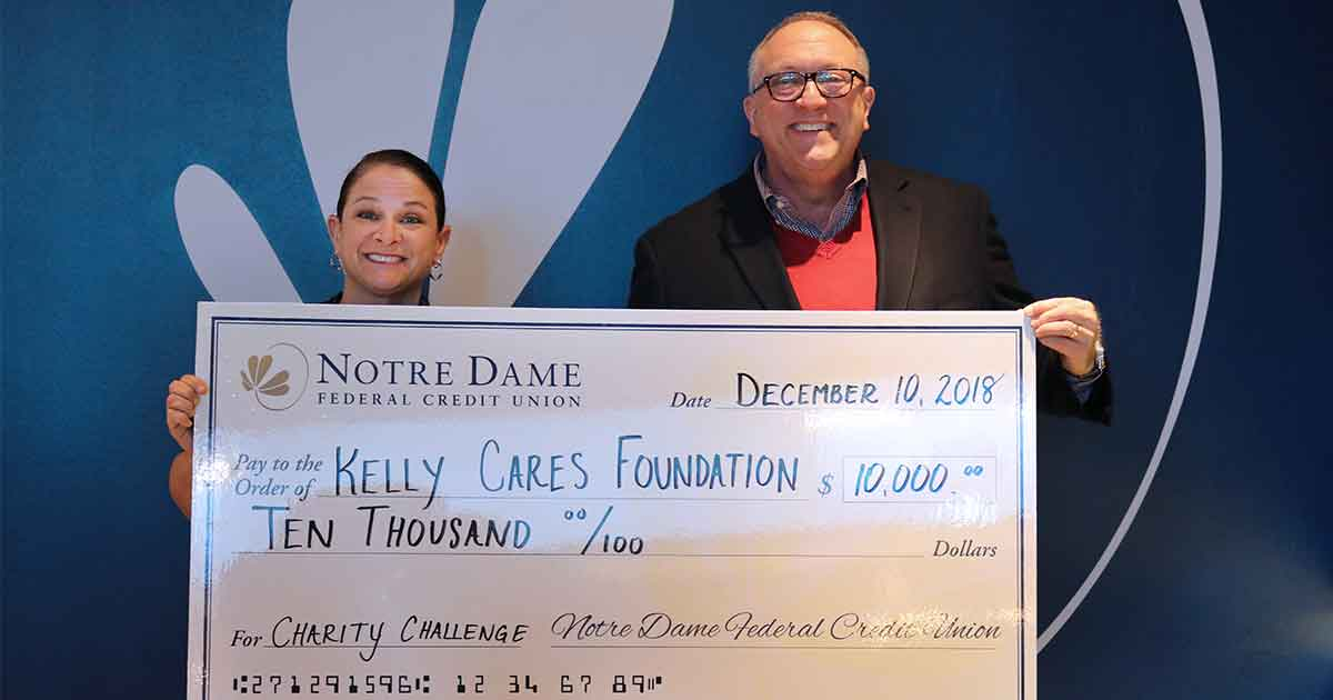 Tom Gryp Presents Paqui Kelly with $10,000 check for the Kelly Cares Foundation